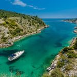 picture of a yacht in a greek inlet