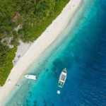 Ariel view over the beach and trees on a Bahamas yacht charter