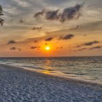 view of a beach at sunset on a luxury Maldives yacht charter