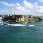view of a castle and island on a Puerto Rico yacht charter