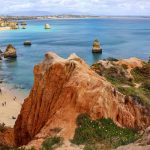 Portugal coastline with cliffs and golden sand on a Europe catamaran charter
