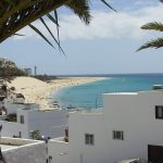 white houses, the beach and ocean on a canaries bareboat charter